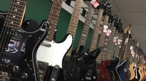 A display of many different guitars