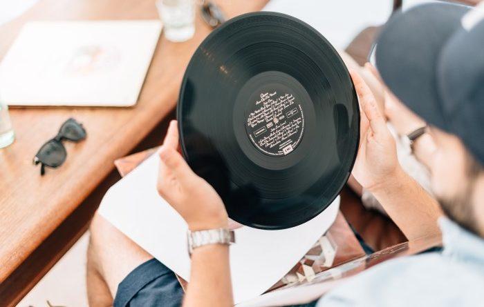 Man looking down at vinyl record