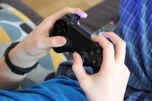 A person playing on a video game console
