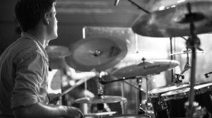 Drummer playing drums on drum set