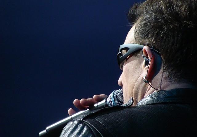 Paul David Hewson singing on a microphone