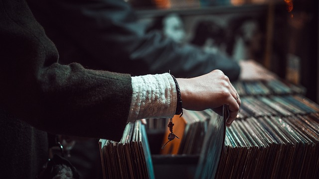 Valuable vinyl records with a person looking through them