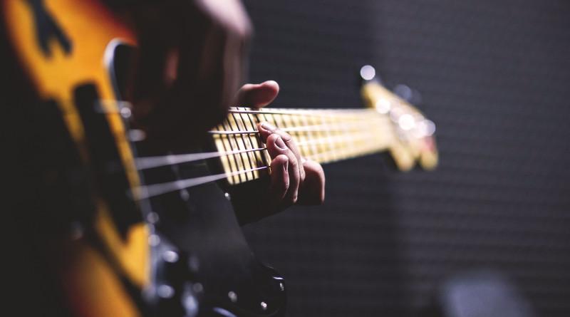 Bassist playing guitar