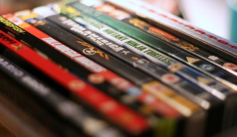 A variety of DVDs in a row