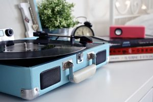 A vinyl record being played in a blue case