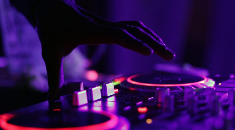 DJ on turn table in the dark