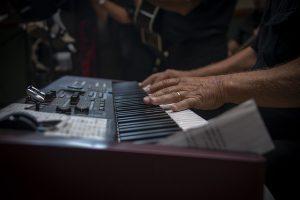 Piano keyboard being played