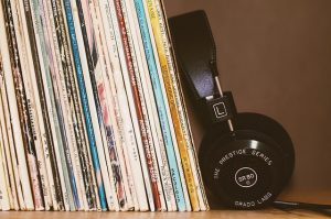 Headphones leaning on vinyl records
