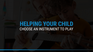 Child playing guitar with parent