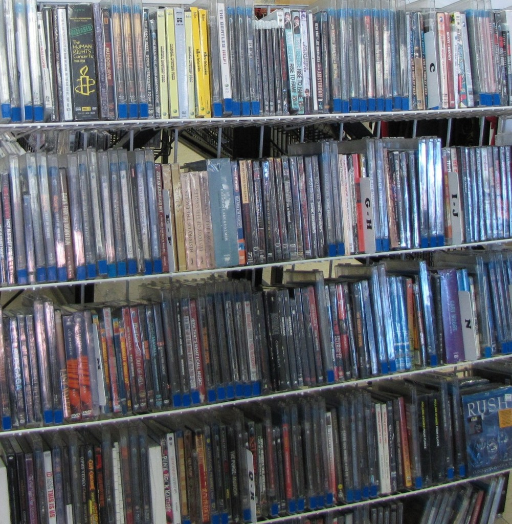 Multiple shelves filled with movie dvds