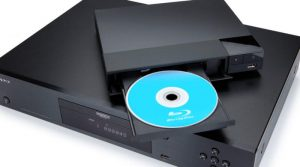 Black blu-ray player with blue blu-ray disc in the disc holder