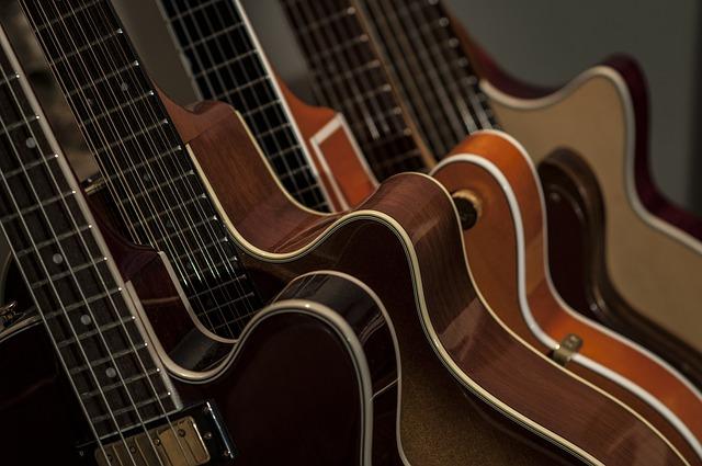 A line up of bass guitars