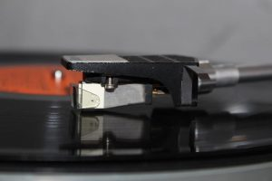 close up of a record playing on a record player