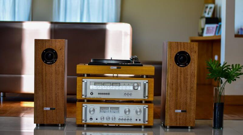Speaker system set up next to two speakers with a record player on top
