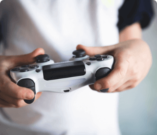 Person using a PlayStation controller